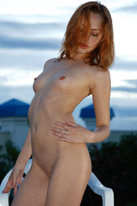 Model Nora F in By the river at sunset