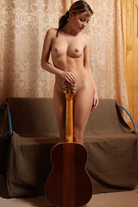 Model Lana Y in Naked Guitarist